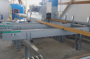 AUTOMATIC LINE FOR SANDING, STRUCTURING AND FLOW-COATING OF OUTBUILDINGS COMPONENTS